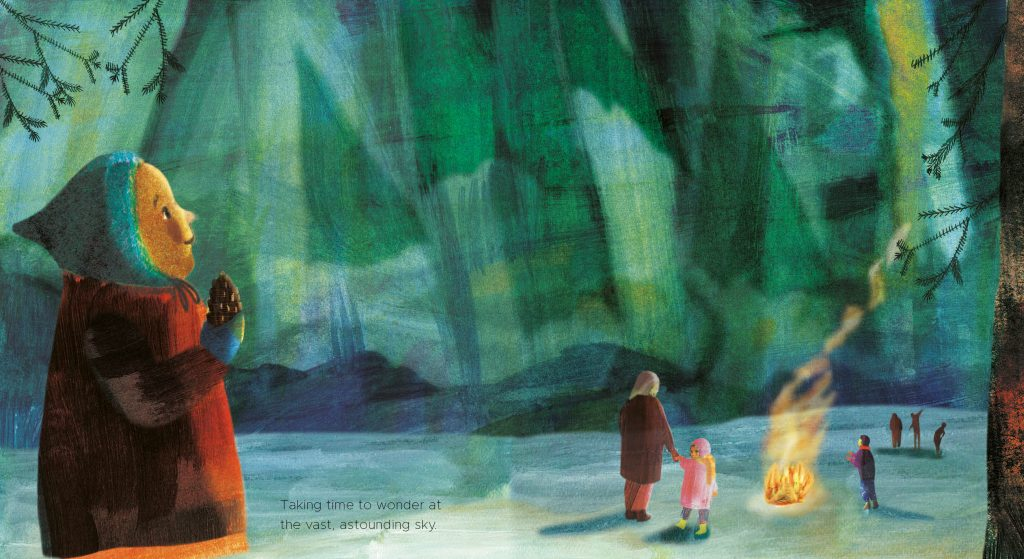 A child stands with her family and watches the northern lights with her family, by a bonfire.