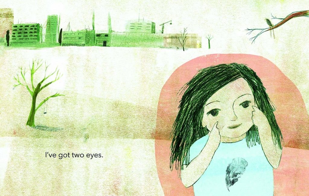 A little girls points to her eyes